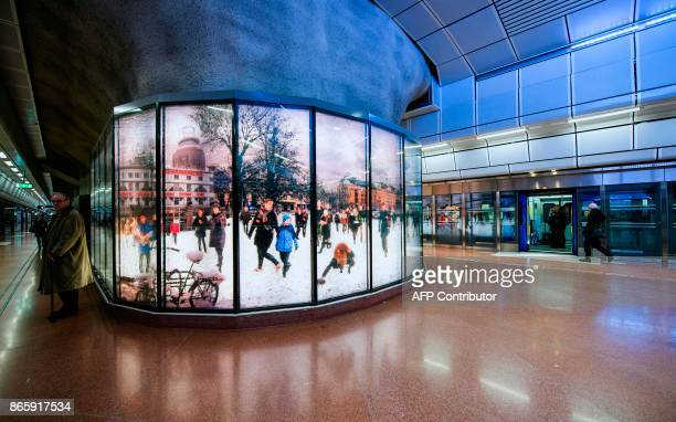People wait for the train at the new city line station of Stockholm City on October 24 2017 The two new commuter train stations Odenplan station and...