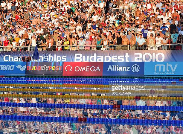 People wait for the women's 100m backstroke final at the European Swimming Championships in Budapest on August 12 2010 AFP PHOTO / JOE KLAMAR