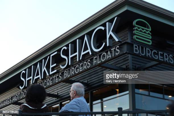 People wait for their order at the Shake Shack restaurant at the Woodbury Common Premium Outlets Mall on October 21, 2017 in Central Valley, NY.