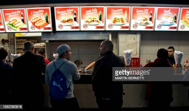 People wait for their orders at a fast food stand in downtown Santiago on October 16 2018 The nutritional prospect of the Chilean population is...