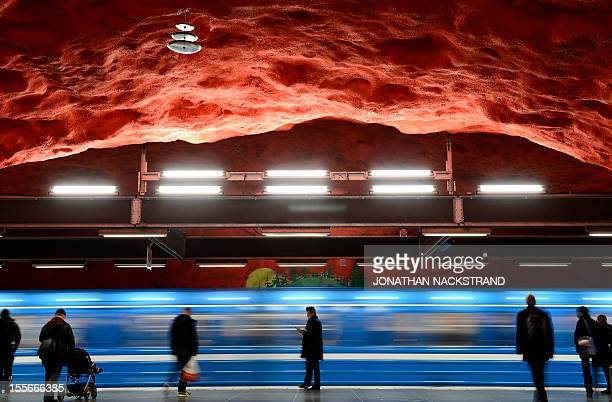 People wait for their train to stop at the Solna subway station on November 6 2012 in Stockholm Sweden decorated in the 1970's by artists Anders...