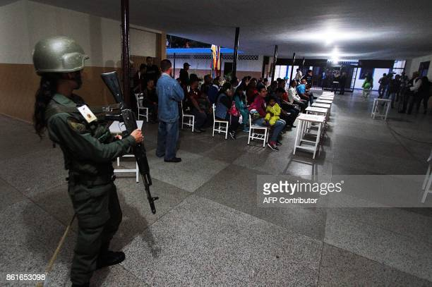 People wait for their turn to vote at a polling station in San Cristobal in Tachira State during regional elections in Venezuela on October 15 2017...