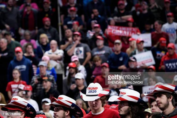 People wait for US President Donald Trump during a Keep America Great rally at the Giant Center in Hershey, Pennsylvania on December 10, 2019.