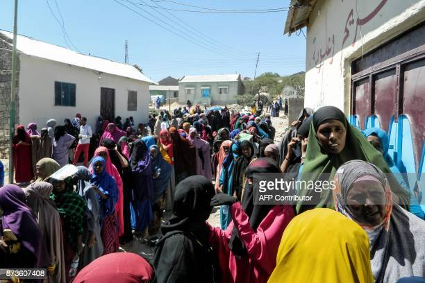 People wait in a line to cast their votes in the Presidential election at a polling station in Hargeisa Somaliland on November 13 2017 Three...