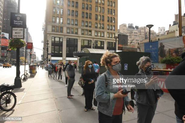 People wait in a line to vote at Madison Square Garden during early voting for the U.S. Presidential election on October 24, 2020 in New York City....