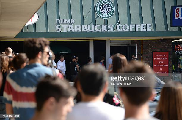 People wait in a long line to get into a coffee shop named Dumb Starbucks February 10 in the Los Feliz area of Los Angeles CA The store resembles a...