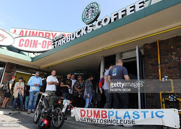 "People wait in a long line to get into a coffee shop named ""Dumb Starbucks"" February 10 in the Los Feliz area of Los Angeles, CA. The store resembles..."