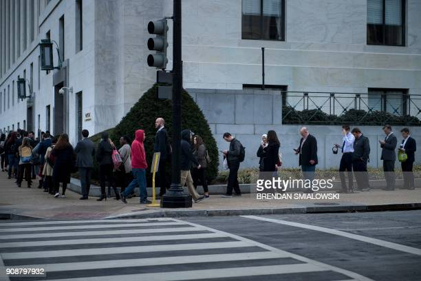 TOPSHOT People wait in a long security line to enter the Dirksen Senate Office Building on Capitol Hill while the US government is shutdown January...