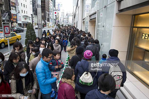 People wait in a queue line for the gate of Matsuya Ginza Department store to purchase the New Year's first winter sale quotFukubukuroquot or...