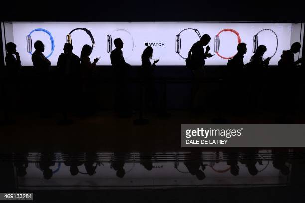 People wait in a queue to test out the new Apple Watch at a store in Hong Kong on April 10 2015 Apple says its first wearable device will connect...