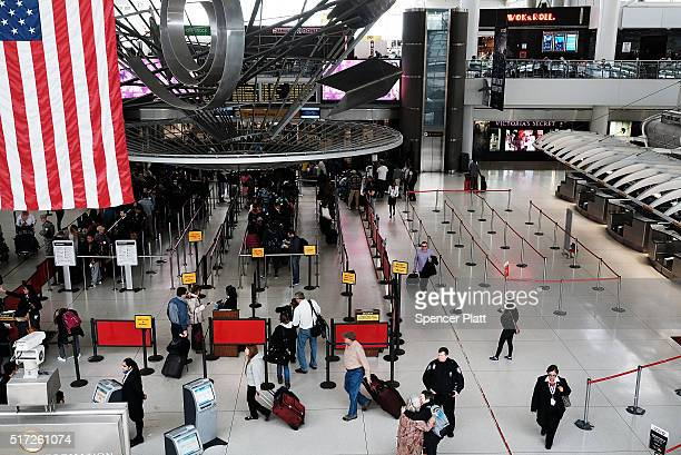 People wait in a security line at John F Kennedy Airport on March 24 2016 in New York City Following the deadly terrorist attacks in Brussels...
