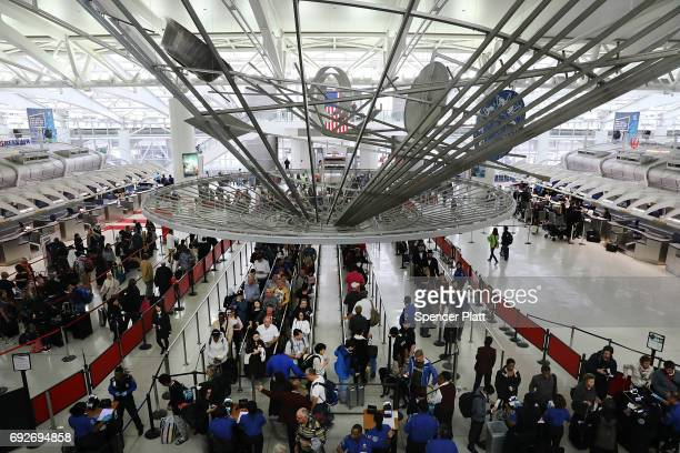 People wait in a security line at John F Kennedy International Airport on June 5 2017 in New York City Part of what the White House is calling the...