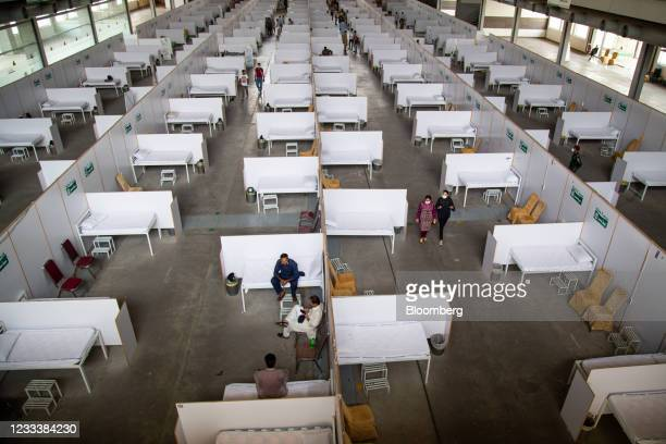 People wait in an observation area after receiving their first dose of the Sinovac Biotech Ltd Covid-19 vaccine at the Lahore International Expo...
