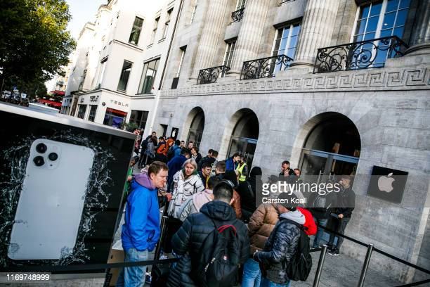 People wait in front of a Apple Store to buy the new Apple iPhone 11 on the first day of the phone's sale at the Apple Store on September 20 2019 in...