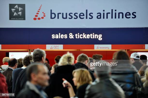 People wait in front of a Brussels Airlines counter at Brussels International Airport in Zaventem on December 18 2009 Dozens of flights were...