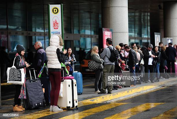People wait in front of Ataturk airport on March 31 in Istanbul after a massive power cut caused chaos Tuesday in large parts of Turkey shutting down...