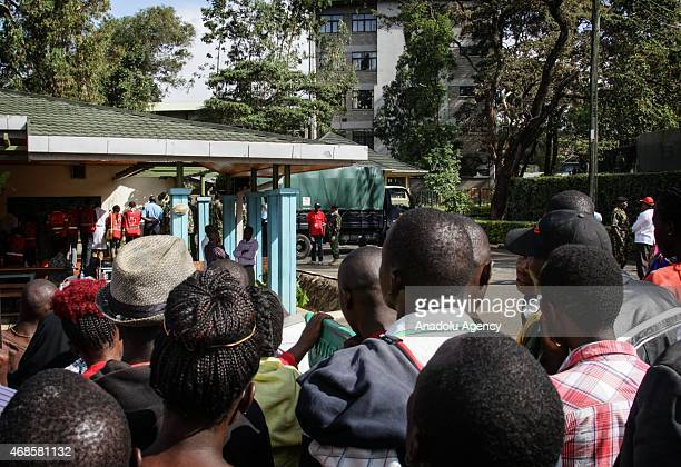 People wait in front of morgue of Chiromo Campus of Nairobi University on April 04 2015 to identify the corps of their relatives killed during the...