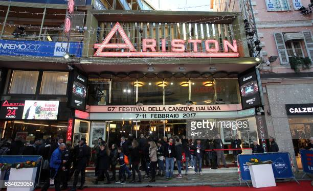 People wait in front of the Ariston Theatre in Sanremo on February 6 before the start of the annual music festival that will begins on February 711...