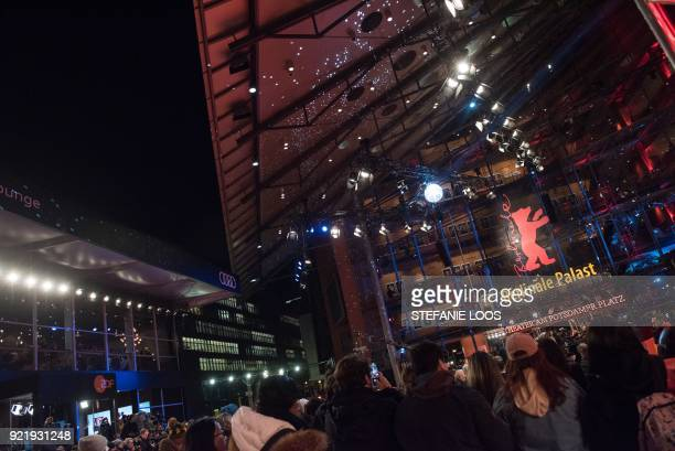 People wait in front of the Berlinale Palace before the premiere of his film 'Don't Worry He Won't Get Far on Foot' presented in competition during...