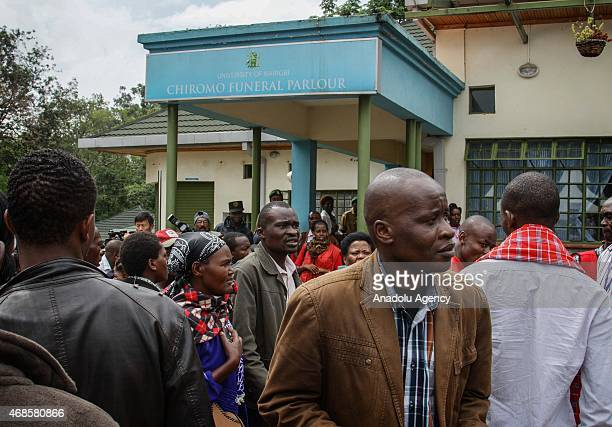 People wait in front of the morgue of Chiromo Campus of Nairobi University on April 04, 2015 to identify the corps of their relatives killed during...
