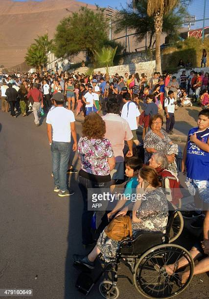 People wait in high areas after hearing a tsunami alert following a quake in Iquique 1800 km north of Santiago Chile on March 16 2014 A powerful...