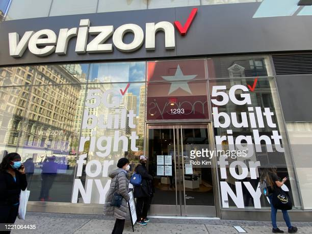 People wait in line at a Verizon store during the coronavirus pandemic on April 25 2020 in New York City COVID19 has spread to most countries around...