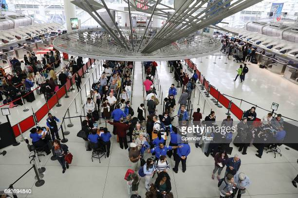 People wait in line at John F Kennedy International Airport on June 5 2017 in New York City Part of what the White House is calling the president's...
