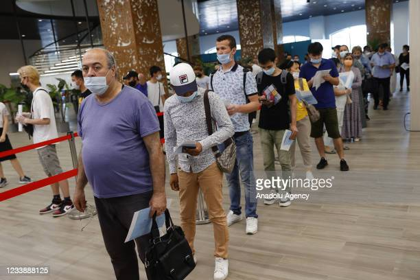 People wait in line at Luzhniki Stadium during the mass vaccination process on July 09, 2021 in Moscow, Russia. As part of the struggle against the...