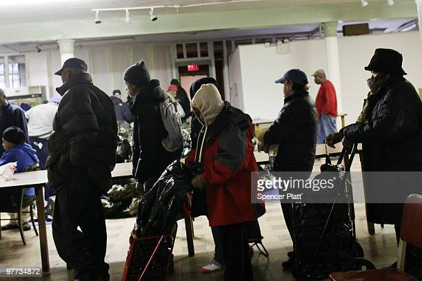 People wait in line at the food pantry at St Augustine's Church on March 15 2010 in the Bronx borough of New York The St Augustine food pantry where...
