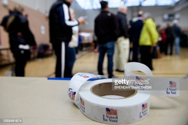 People wait in line during early voting at a community center October 25, 2018 in Potomac, Maryland, two weeks ahead of the key US midterm polls.