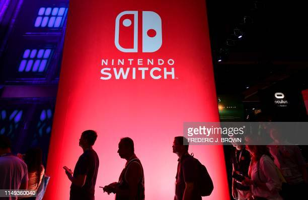 People wait in line for a chance to sample new games for Nintendo Switch at the 2019 Electronic Entertainment Expo, also known as E3, opening in Los...