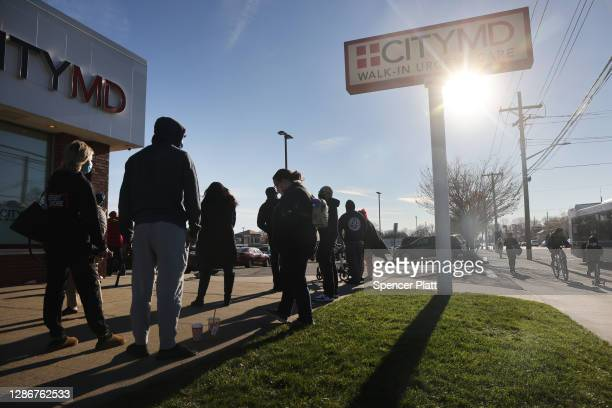 People wait in line for a COVID-19 test at a medical clinic near the Staten Island neighborhood of Tottenville on November 20, 2020 in New York City....