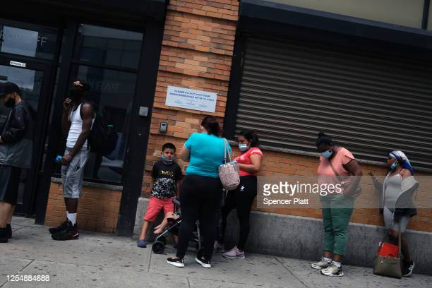 People wait in line for food assistance cards on July 07, 2020 in the Brooklyn borough of New York City. A report issued by the Center for New York...
