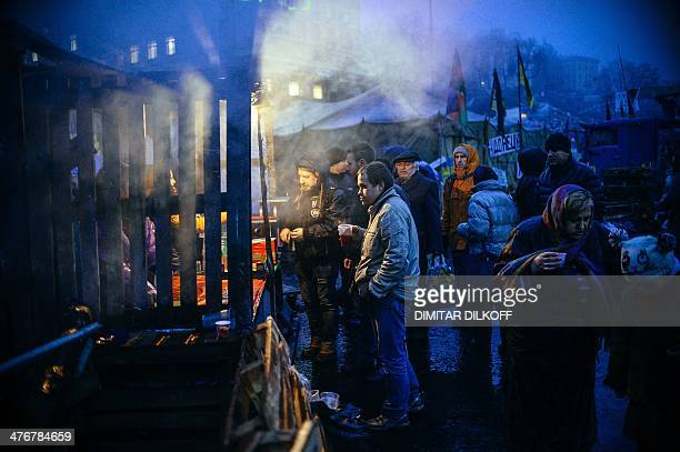 People wait in line for food distribution at Independence Square in Kiev on March 5 2014 US Treasury Secretary Jacob Lew warned Russia on Wednesday...