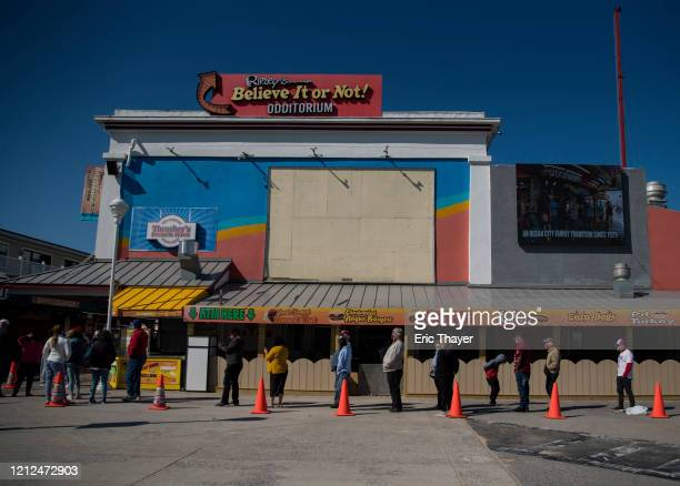 People wait in line for fries on the boardwalk on May 10 2020 in Ocean City Maryland A popular summer tourist destination Ocean city reopened the...