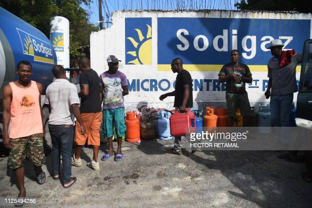 People wait in line for fuel in the commune of Petion Ville in the Haitian Capital PortauPrince on February 17 2019 The government presented a...