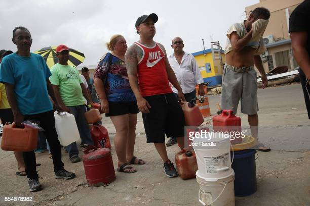 People wait in line for gas as they deal with the aftermath of Hurricane Maria on September 27 2017 in Corozal Puerto Rico Puerto Rico experienced...