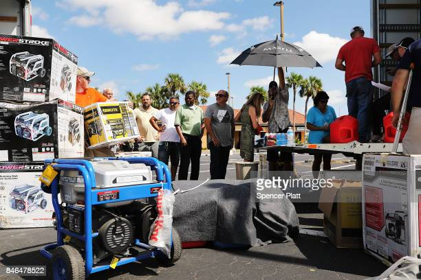 People wait in line for generators three days after Hurricane Irma swept through the area on September 13 2017 in Naples Florida Hurricane Irma made...