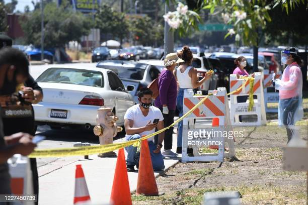 People wait in line for walk-up COVID-19 testing, July 15, 2020 at Lincoln Park in Los Angeles, California. - Los Angeles County Public health...