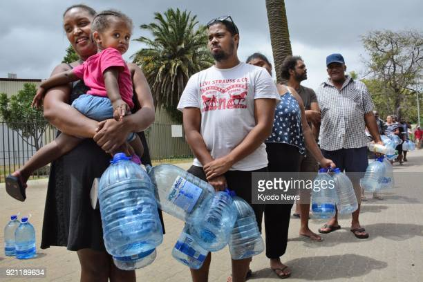 People wait in line for water in Cape Town on Feb 16 2018 In June the South African city is expected to become the first major world city to...