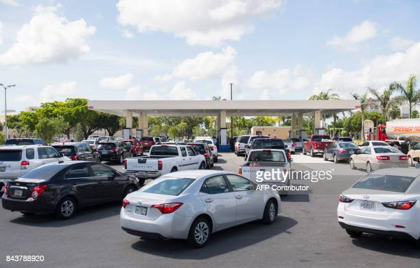 People wait in line in for gas for their cars at a Costco Gas Station as they prepare for Hurricane Irma in Miami Florida September 7 2017 Miami...