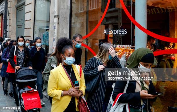 People wait in line in front of the AliExpress pop-up store in Paris on September 24, 2020. - The global marketplace of Chinese e-commerce giant...