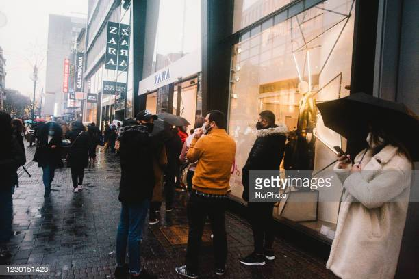 People wait in line in front of Zara clothing retailer store for last day Christmas shopping, in Cologne, Germany, on December 15, 2020.
