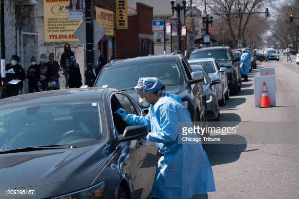 People wait in line in their cars to get tested for COVID19 at Roseland Community Hospital on April 3 2020
