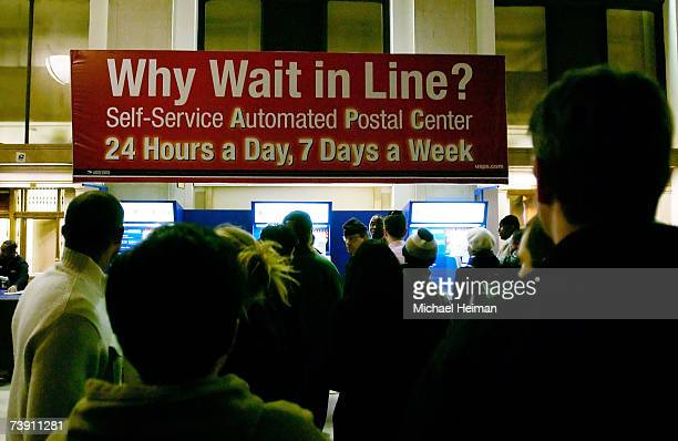 People wait in line inside the James A Farley post office building in the late evening April 17 2007 in New York City With the tax deadline of...