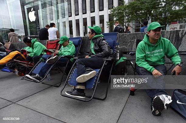 People wait in line on chairs September 9 2014 outside the Apple Store on 5th Avenue in New York Tech trendsetter Apple charts its future course...