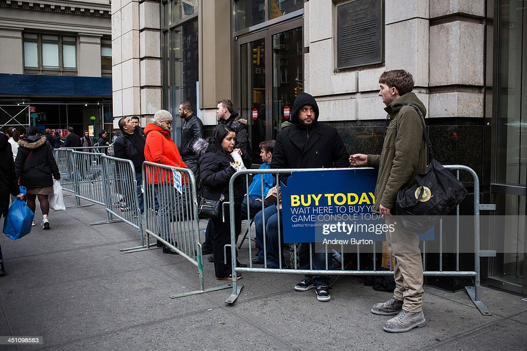 People wait in line outside a Best Buy to buy an XBox One, a new video game and home entertainment system made by Microsoft, on November 21, 2013 in New York City. The console goes on sale at 12:00 AM on Friday, November 22, 2013 and will compete directly with Sony's Playstation 4 this holiday season.