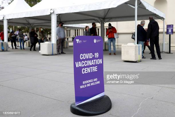 People wait in line outside a COVID-19 vaccination facility set up at the Royal Melbourne Exhibition Center on May 29, 2021 in Melbourne, Australia....