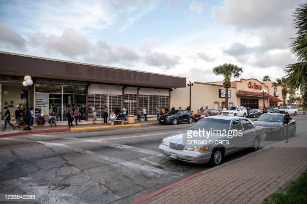 People wait in line outside CDL Plasma on May 25, 2021 in Brownsville, Texas. - Many people cross the border from Mexico to donate plasma for extra...