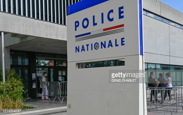 People wait in line outside Lille central police station on May 20, 2020 where a case of COVID-19 infection has been discovered, and two other people...